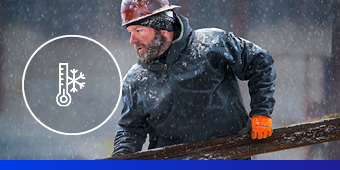 Construction worker in falling snow