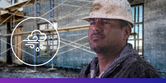 Construction worker in driving rain/sleet