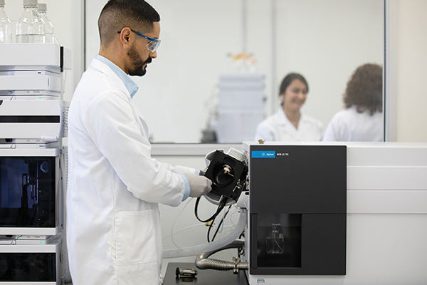 Scientist in lab with Agilent 6470B LC/TQ
